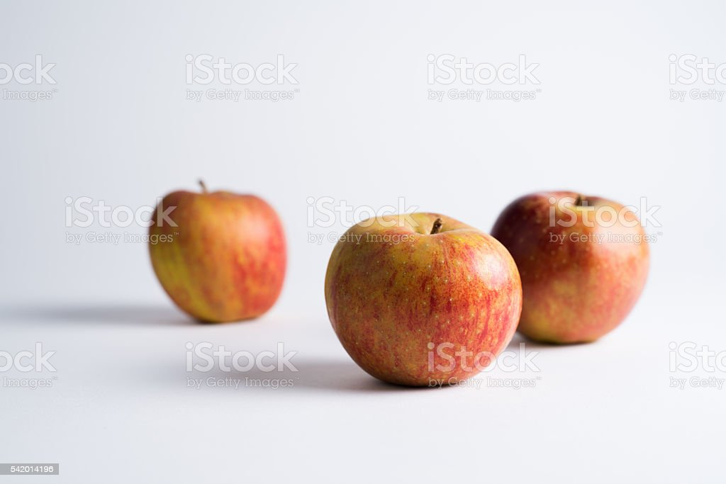 Three Red Apples On White stock photo
