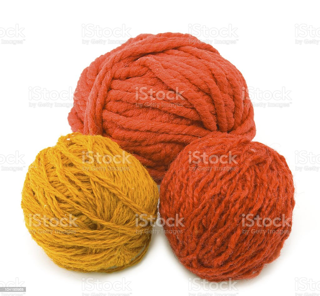 three red balls of threads stock photo