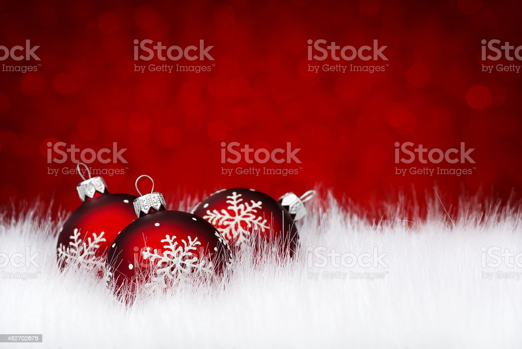 Three red baubles on snow royalty-free stock photo