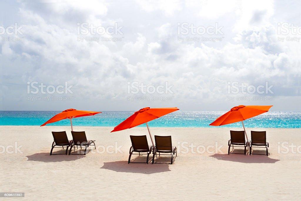 Three Red Beach Umbrellas stock photo