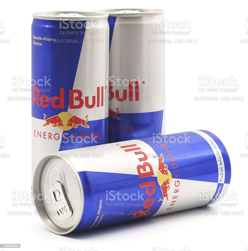 Three Red Bull cans isolated on white stock photo