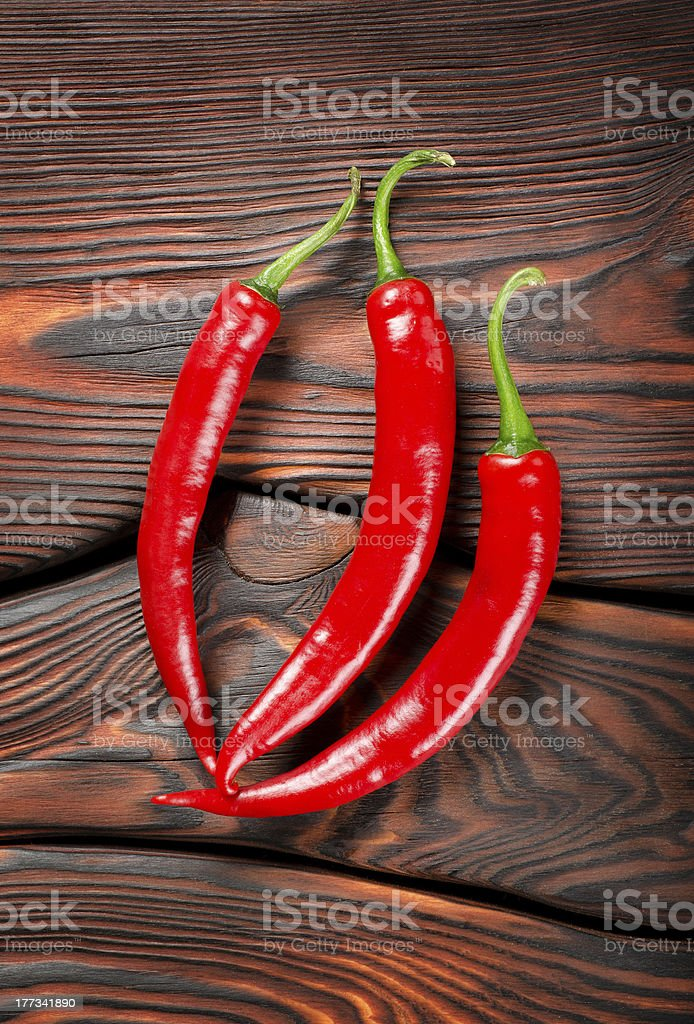 Three red chili peppers royalty-free stock photo