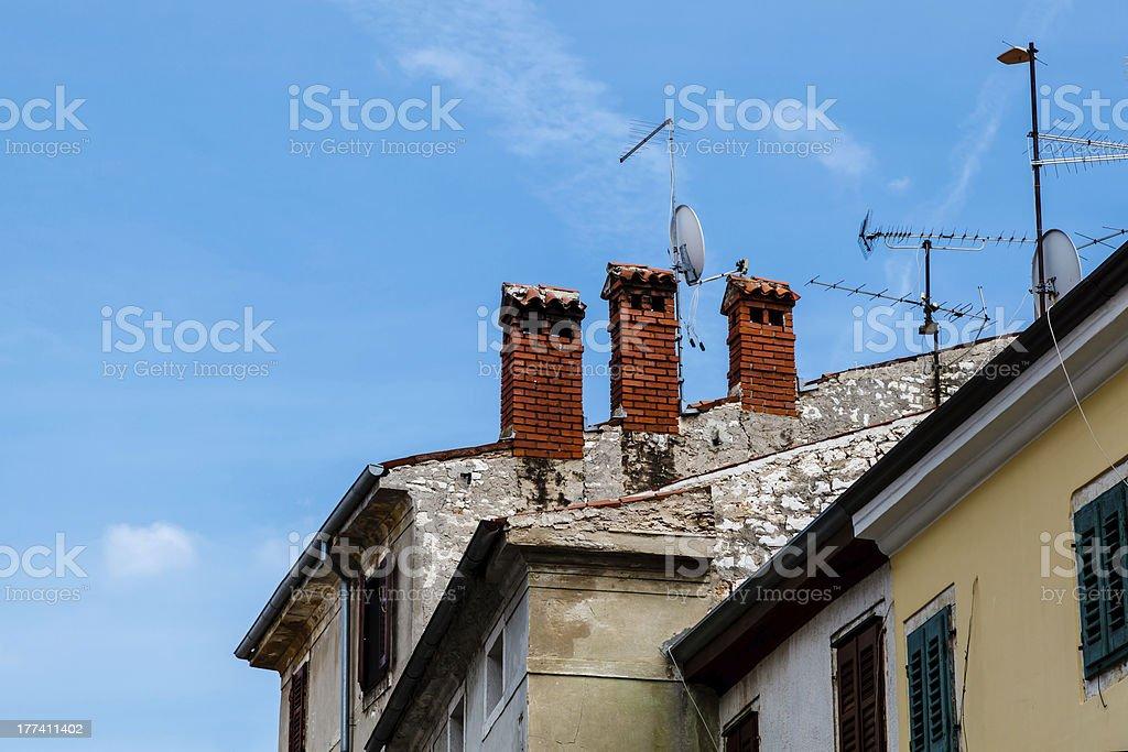 Three Red Chimneys on Roof in Porec, Croatia royalty-free stock photo