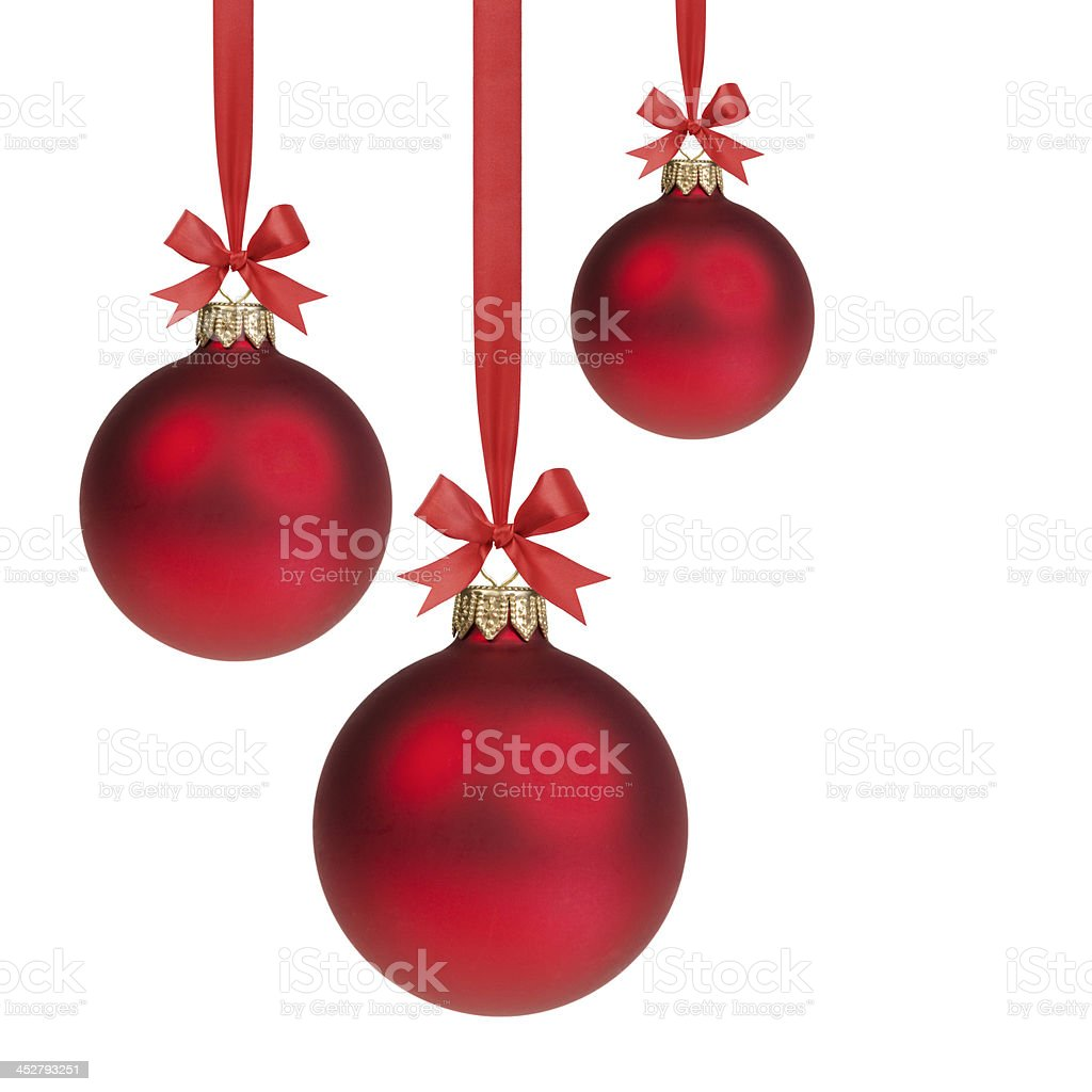 three red christmas balls hanging on ribbon with bows stock photo