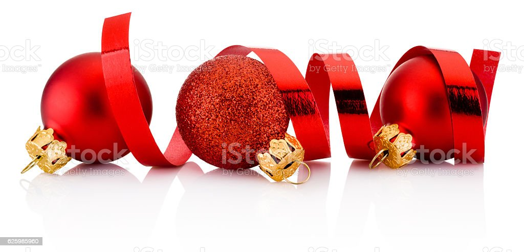 Three red Christmas baubles and curling paper isolated on white stock photo