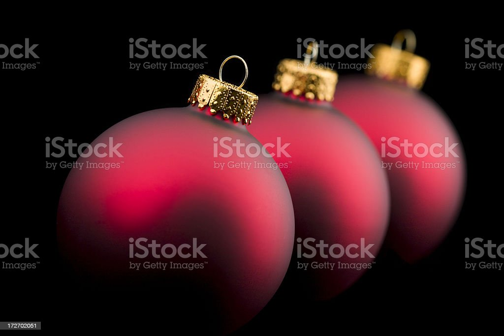Three Red Christmas Ornaments At An Angle stock photo