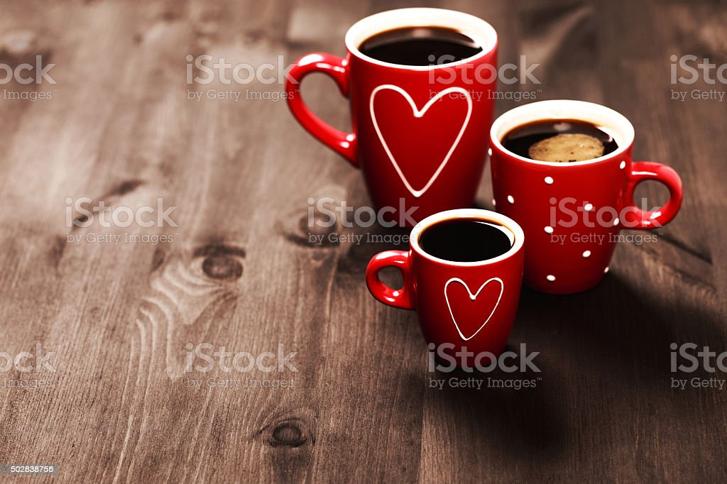 Three red coffee cups stock photo
