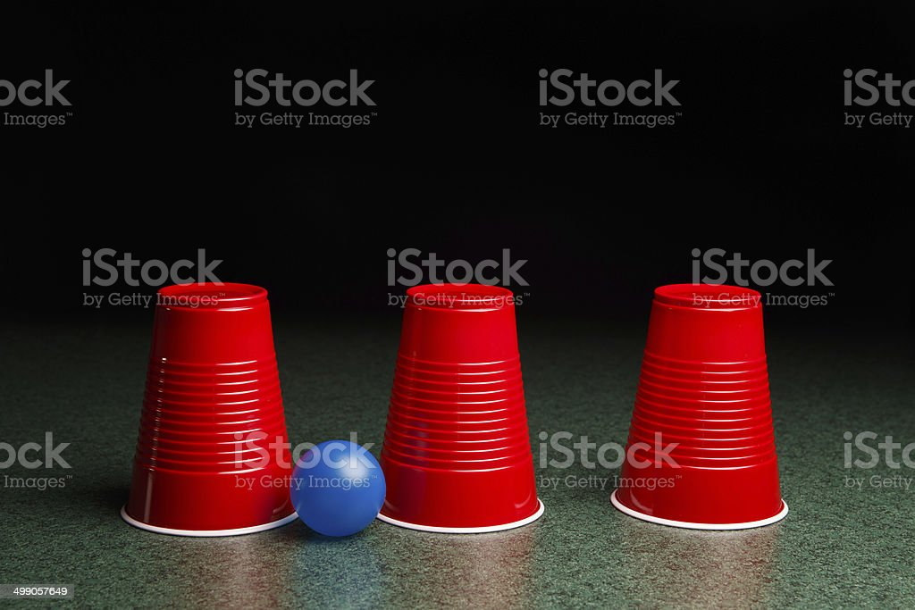 Three Red Cups and a Blue Ball stock photo