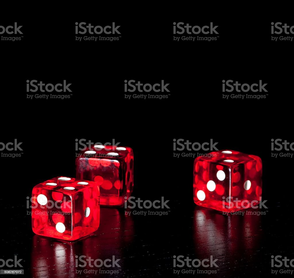 three red dice on old wood black table stock photo