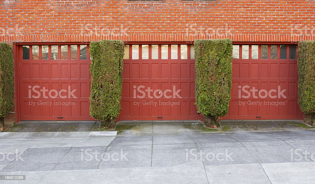 Three Red Garages royalty-free stock photo