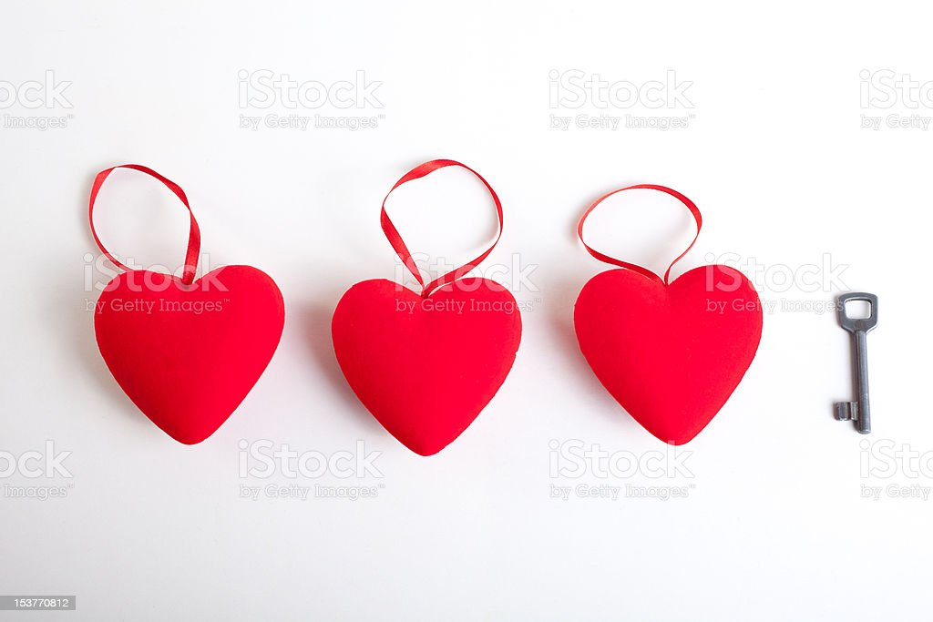Three Red hearts with ribbons and a key royalty-free stock photo