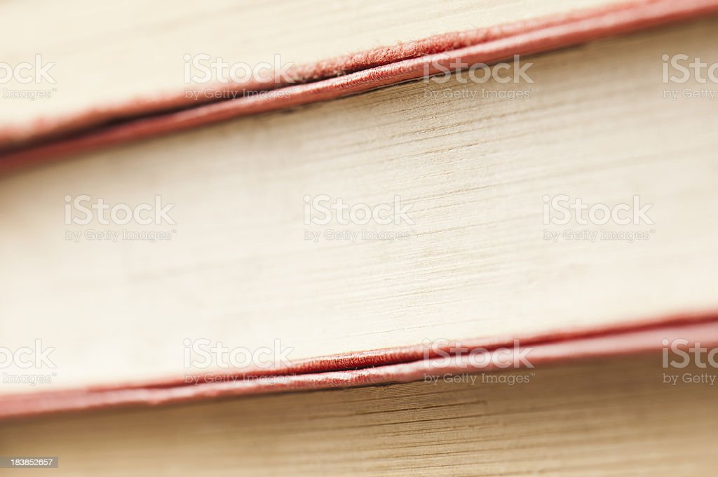 Three red leather covered books with copy space royalty-free stock photo