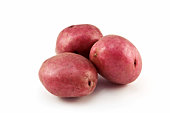 Three red potatoes on a white background