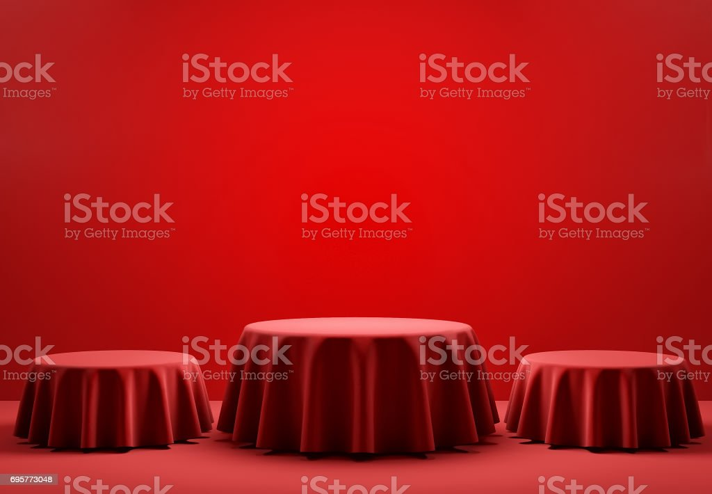 Three red round podiums in the scene. 3d render stock photo