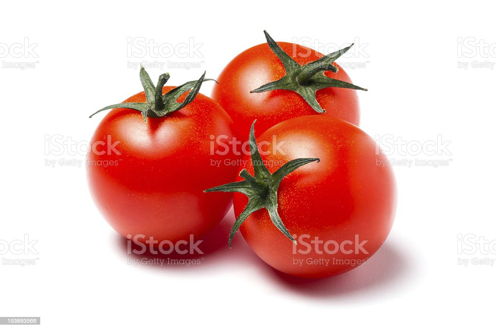 Three red tomatoes stock photo