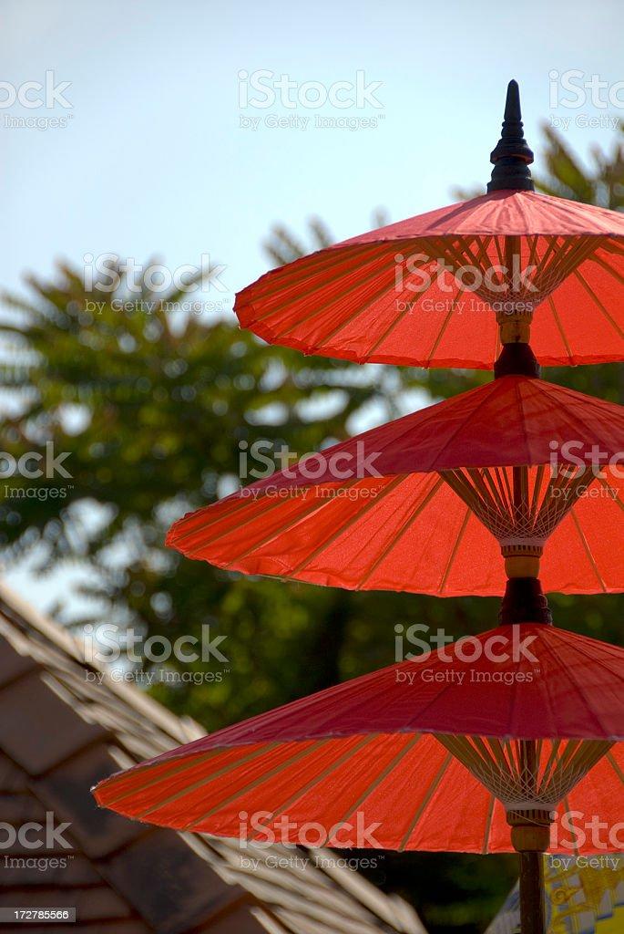 Three Red Umbrellas and Trees stock photo