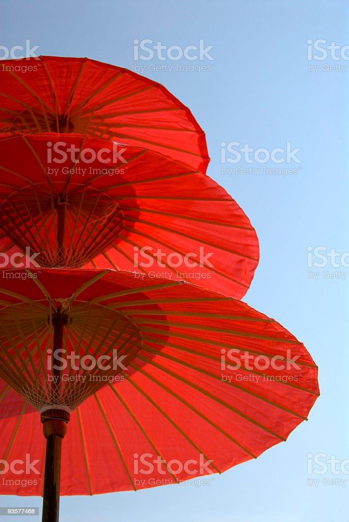 Three Red Umbrellas stock photo