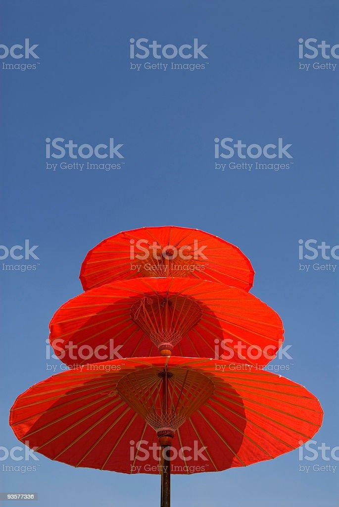 Three Red Umbrellas Vertical stock photo