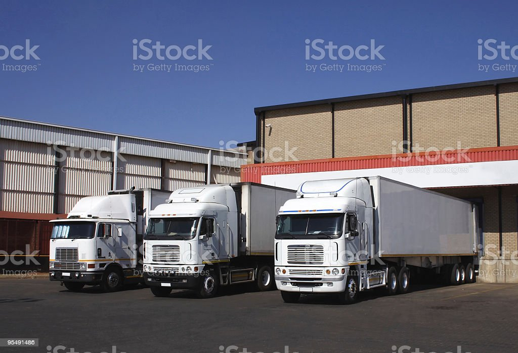 Three refrigerated transporters at a frozen good warehouse. stock photo