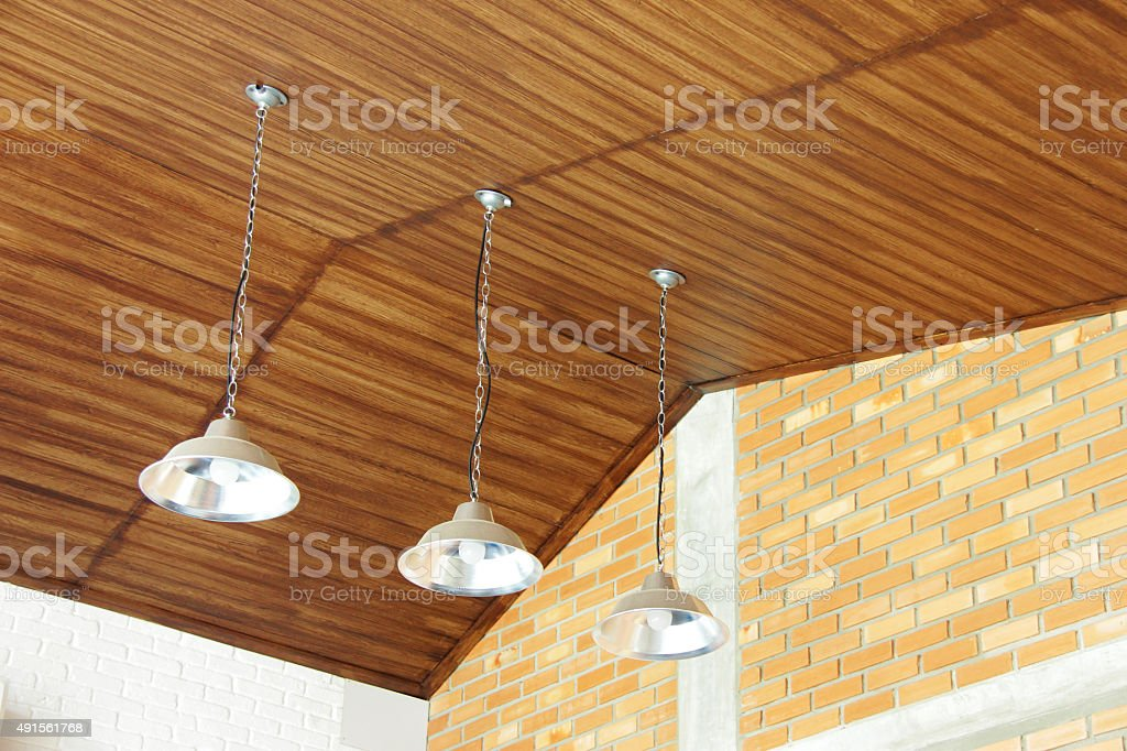Three retro lamps hanging from ceiling stock photo