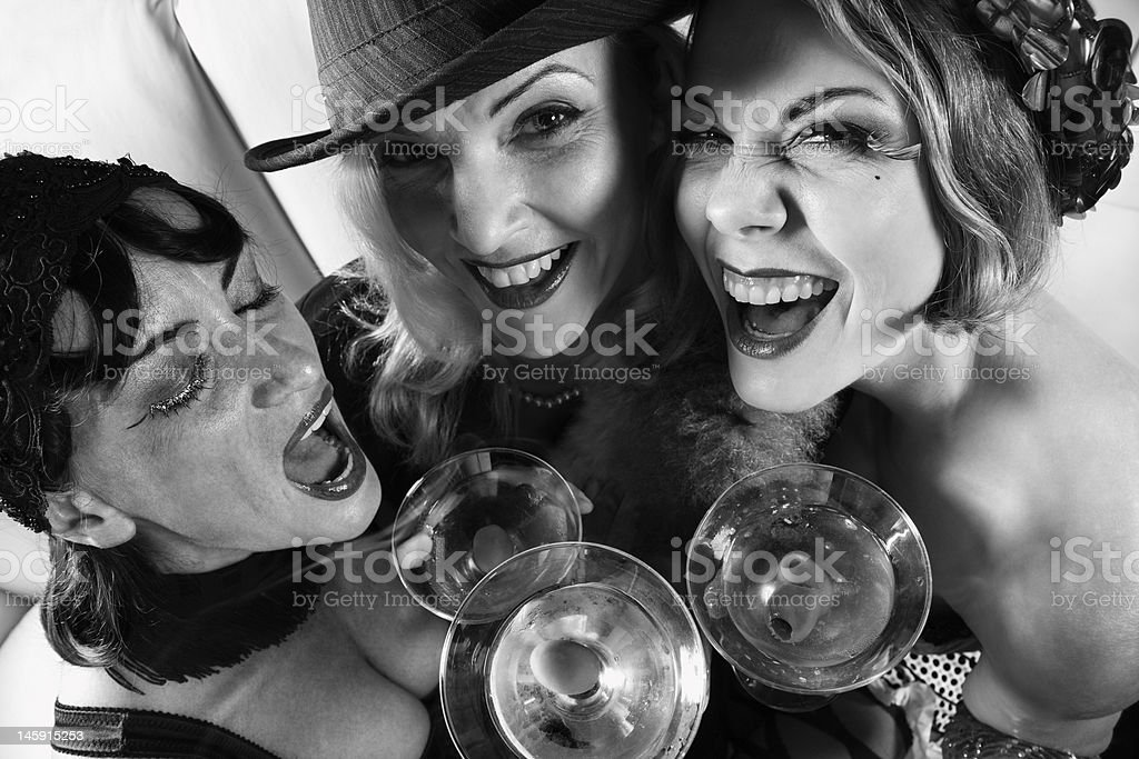 Three retro women drinking. stock photo