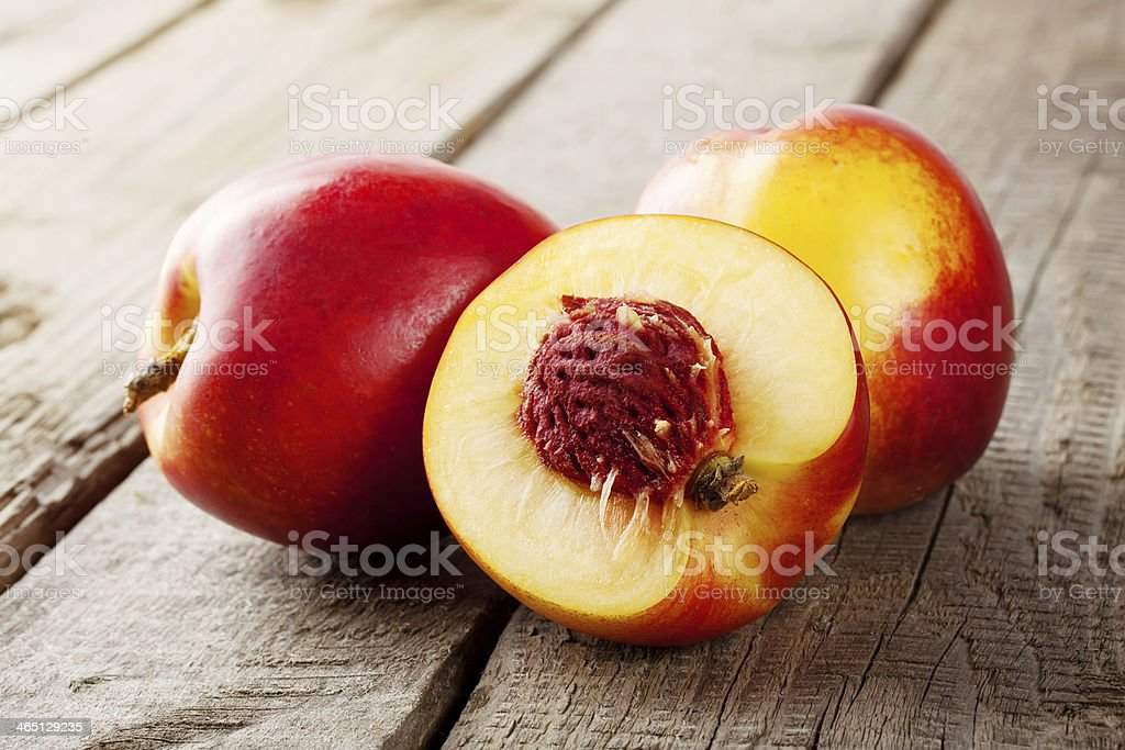 Three ripe juicy nectarine stock photo