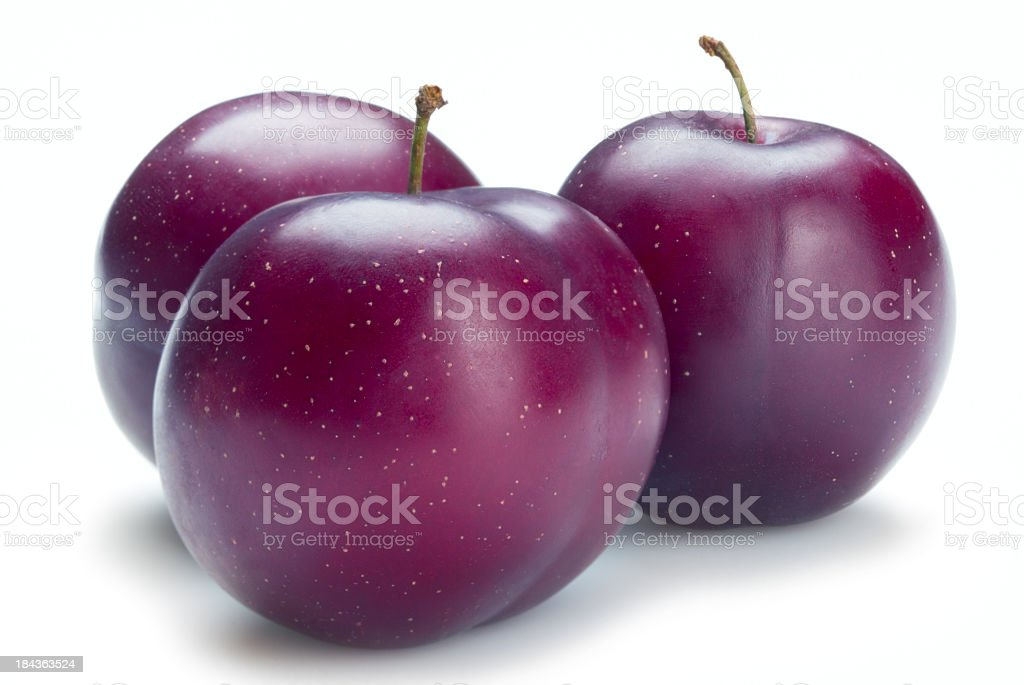 Three ripe plums isolated on a white background royalty-free stock photo