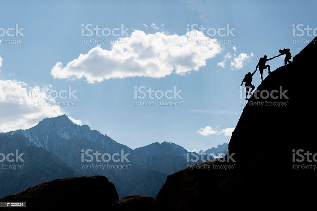 Three rock climbers stock photo