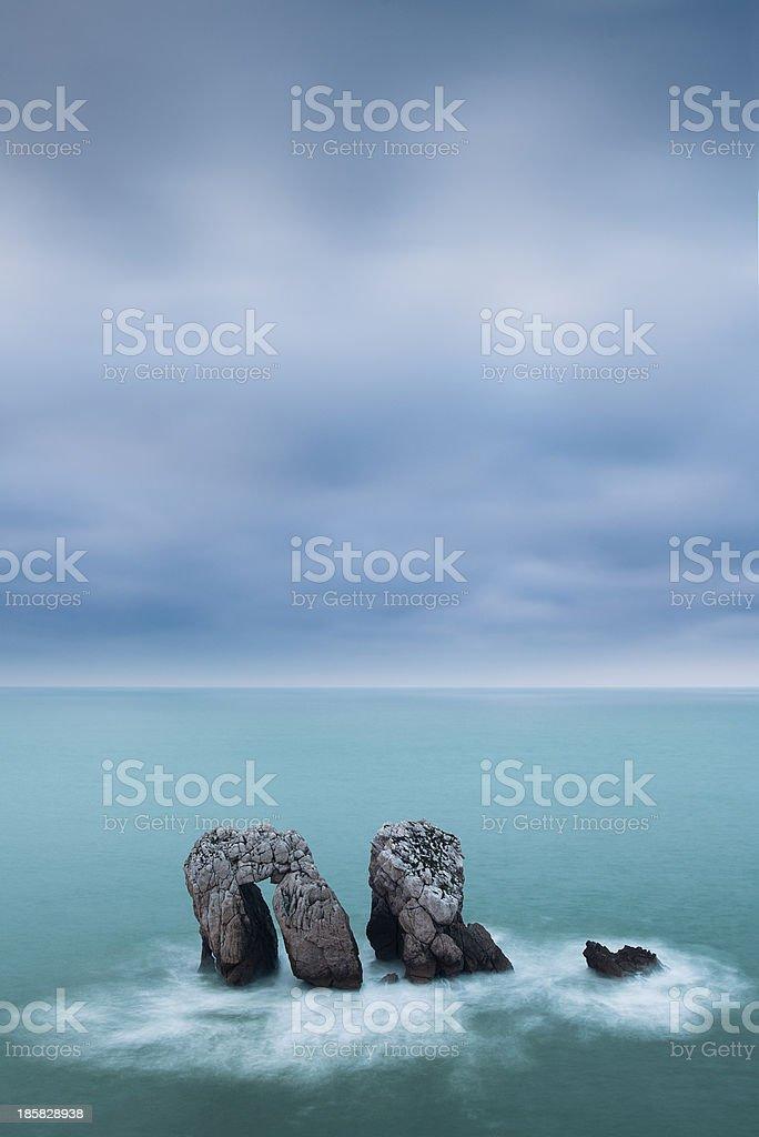 Three rocks at the Cantabrian sea stock photo