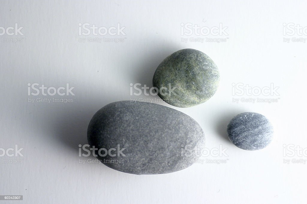 Three round smooth pebbles on a white background royalty-free stock photo