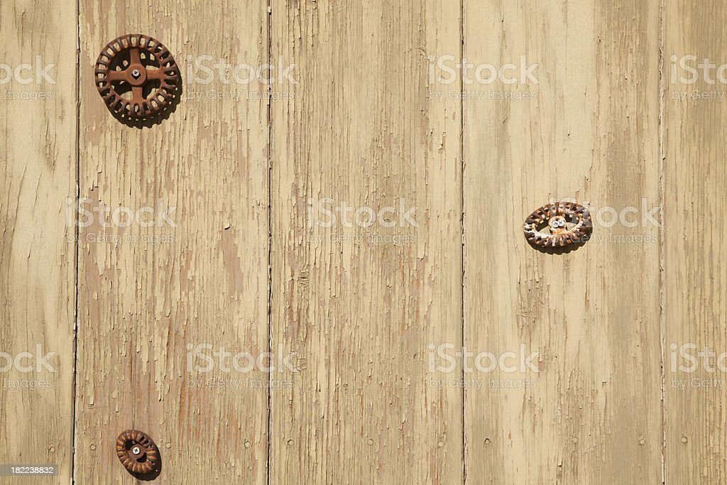 Three Rusted Faucet Handles On Green Painted Barn Wall royalty-free stock photo