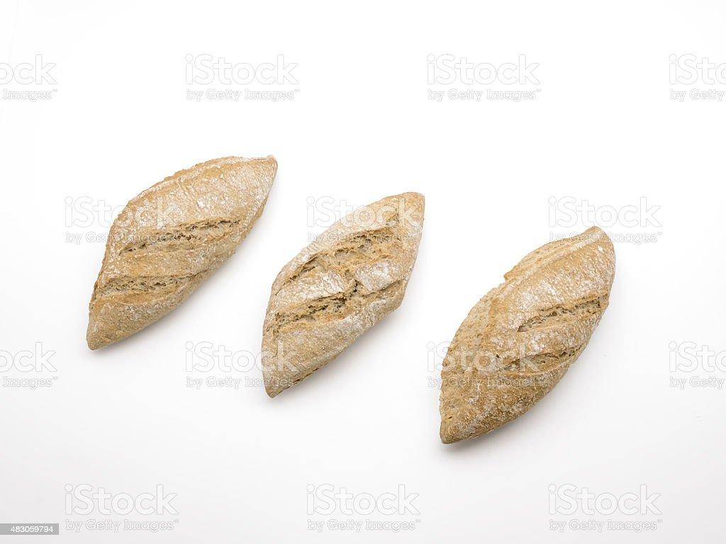 Três rústica baguetes isolado no fundo branco foto royalty-free
