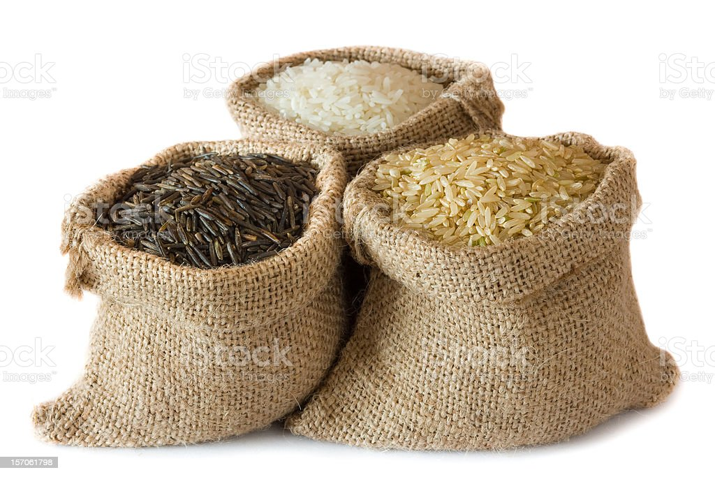 Three sacks of different grain rice stock photo