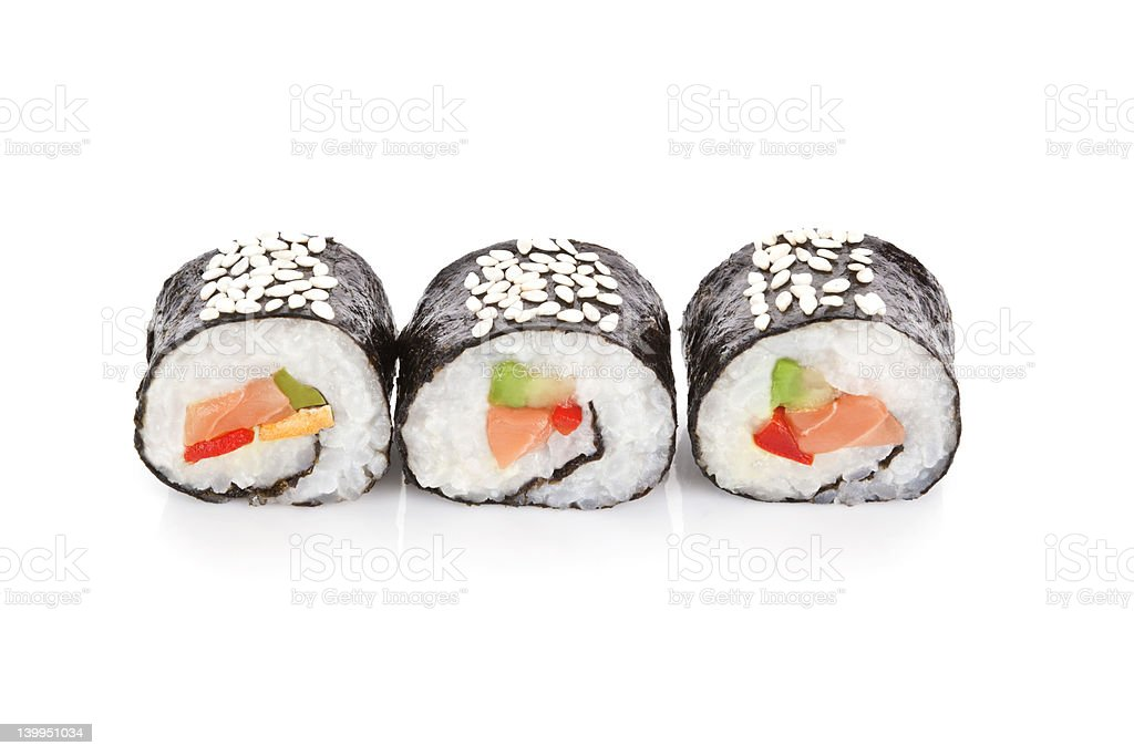 Three salmon sushi rolls sprinkled with sesame seeds stock photo
