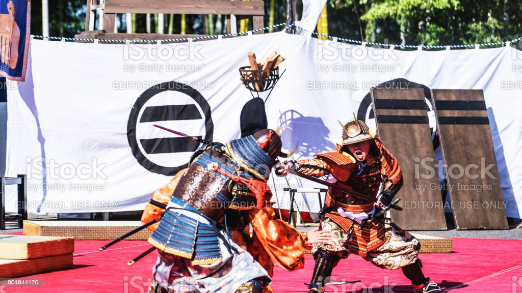 Three samurai fighting by sword for a performance of historical war in Japan stock photo