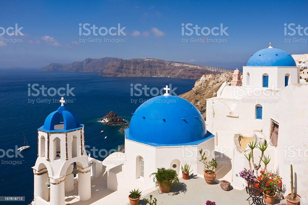 three Santorini churches against the mediterranean ocean royalty-free stock photo