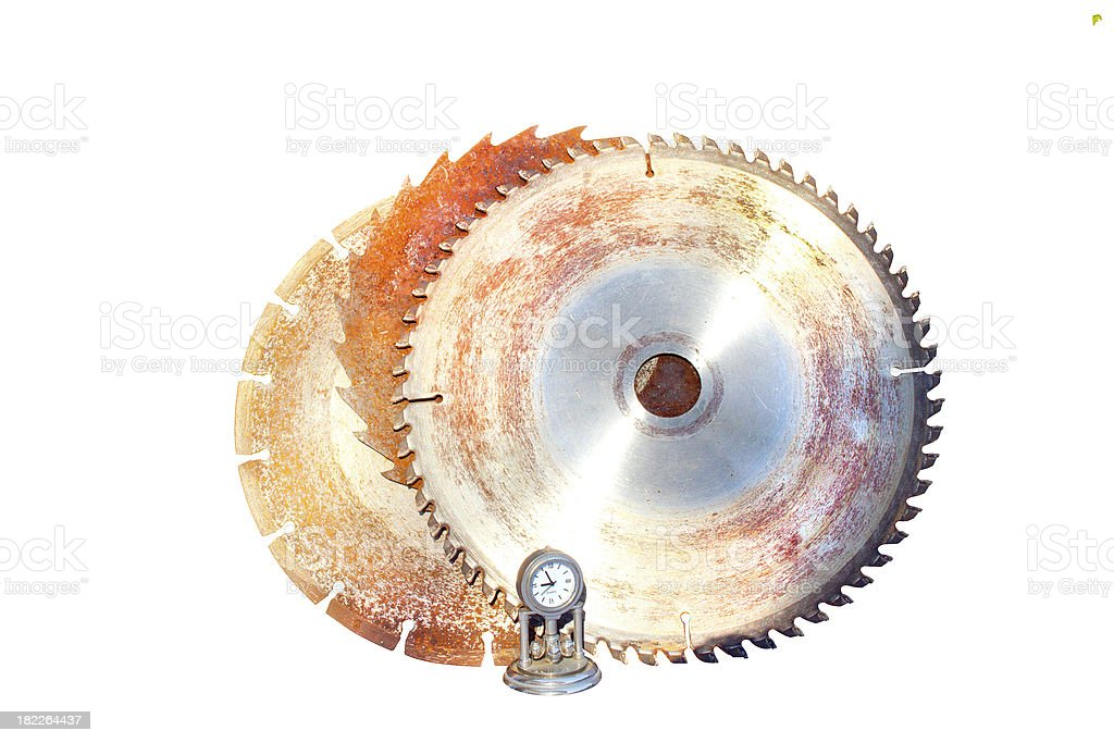 Three Saw Blades With Time Clock royalty-free stock photo