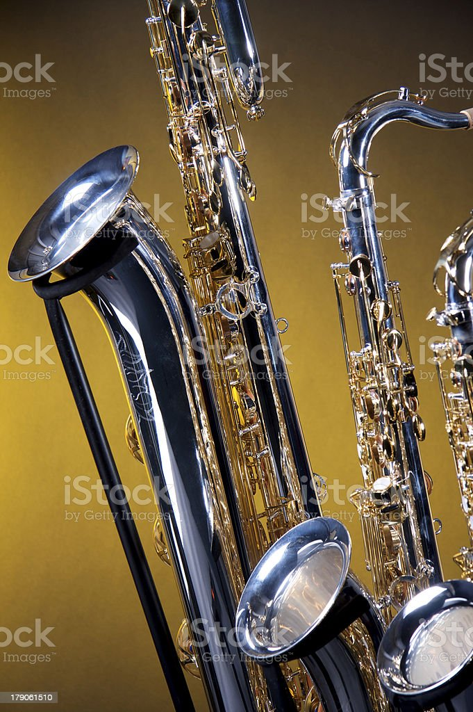 Three Saxophones on Yellow stock photo