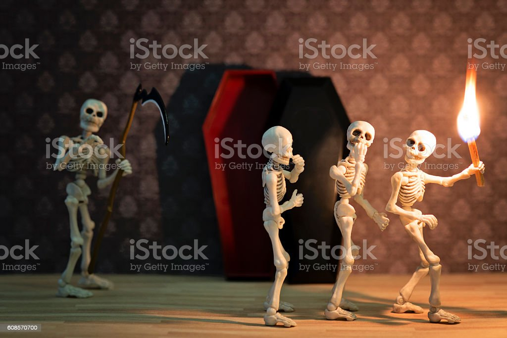 Three scared skeletons stock photo