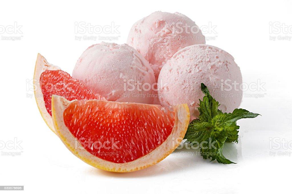 Three scoops of grapefruit ice cream stock photo