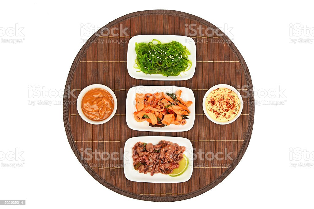 Three seafood salads on bamboo mat royalty-free stock photo