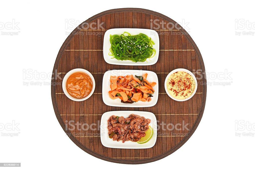 Three seafood salads on bamboo mat stock photo