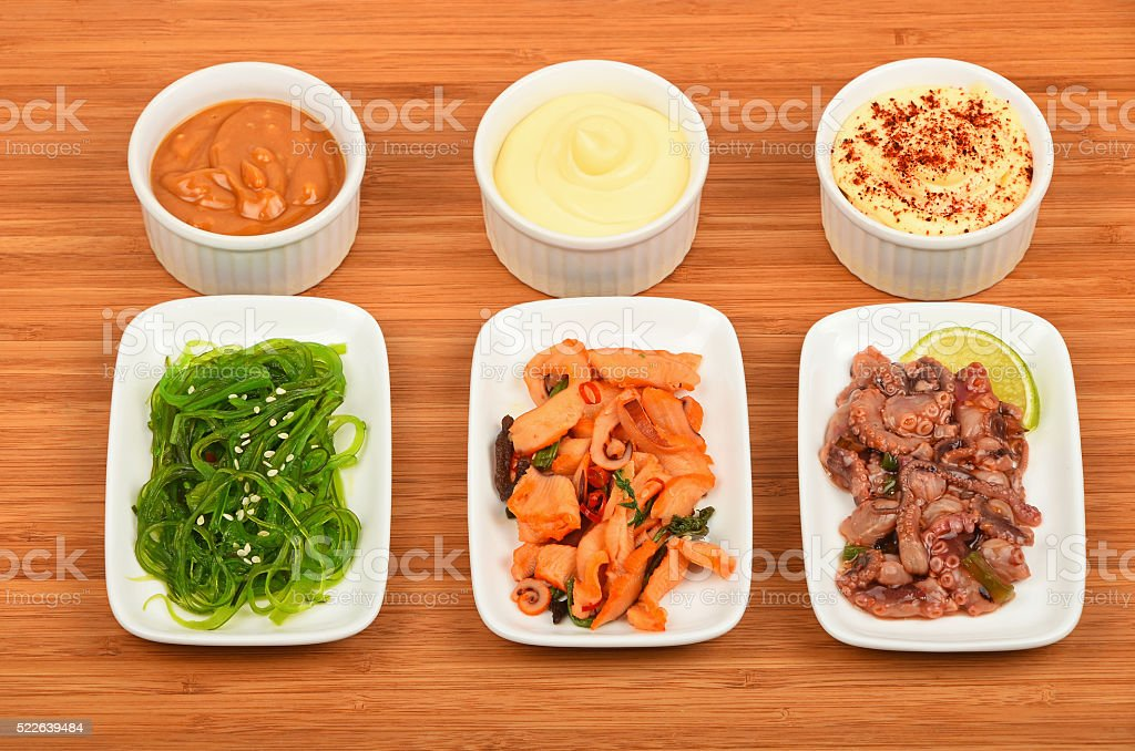 Three seafood salads with sauce on wood royalty-free stock photo