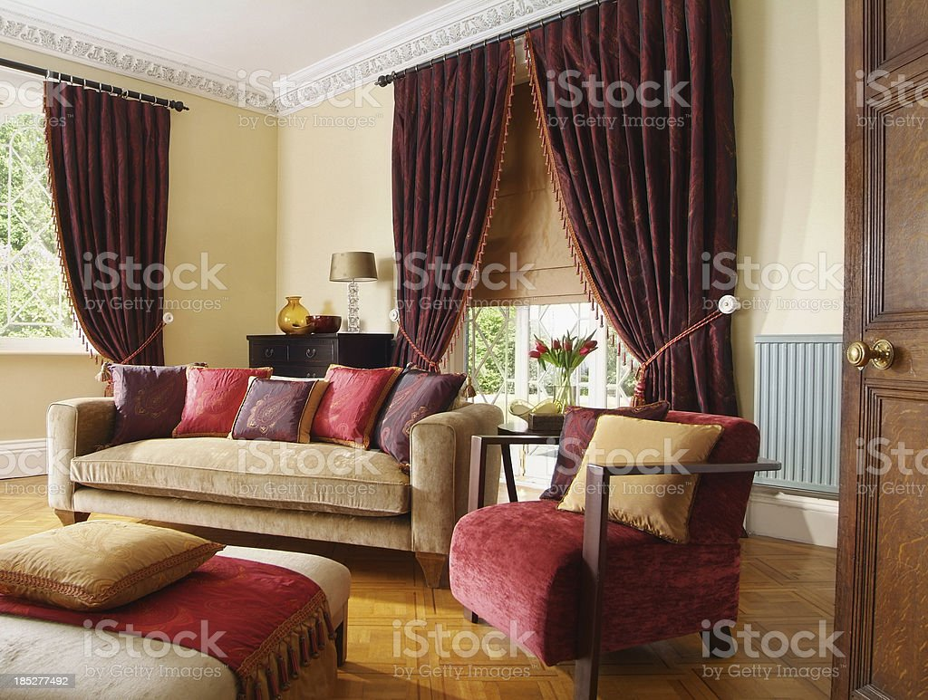 Three seater sofa and chair in living room stock photo