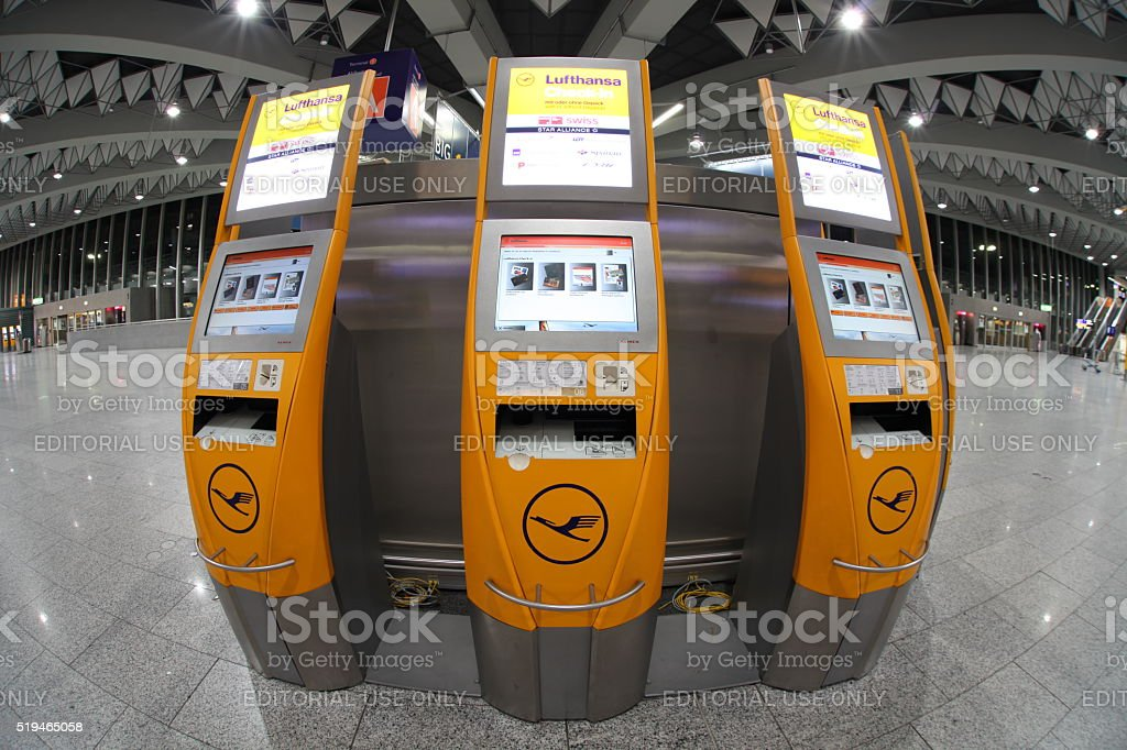 Three self check in counters at airport - fisheye stock photo