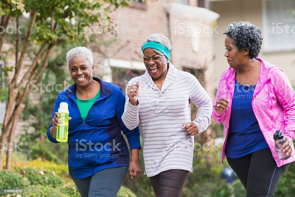 Three senior black women exercising together stock photo