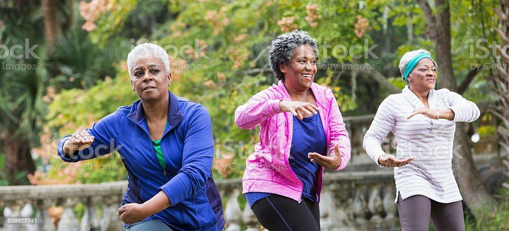 Three senior black women practicing Tai Chi stock photo