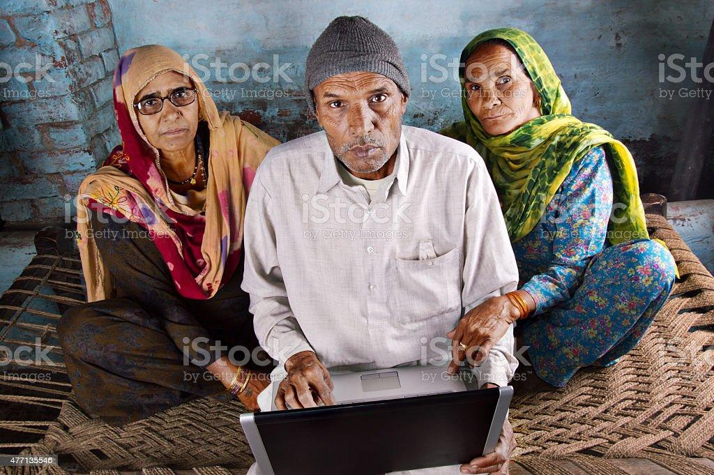 Three Seniors with Laptop stock photo