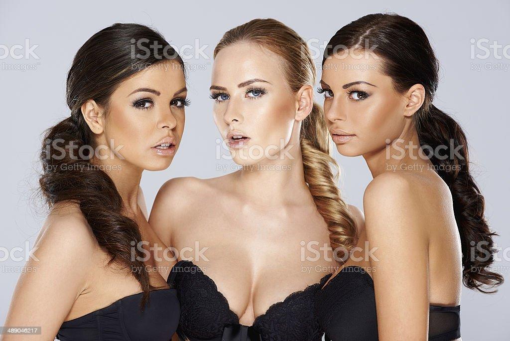 Three sensual beautiful young women stock photo