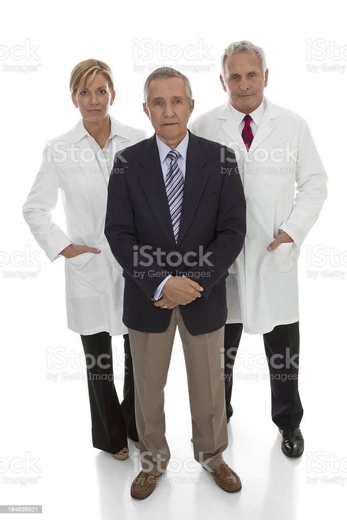 Three serious professionals standing white background stock photo